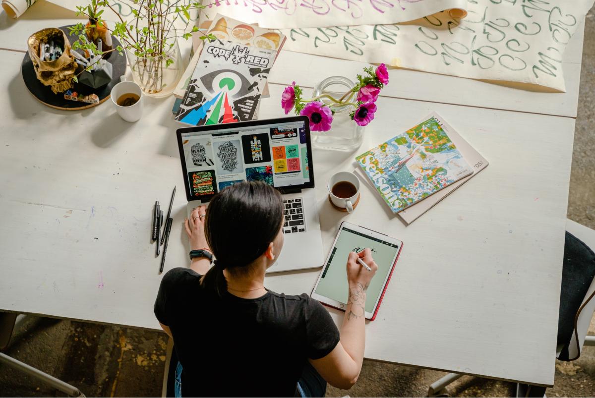 A visual designer sitting at her desk.
