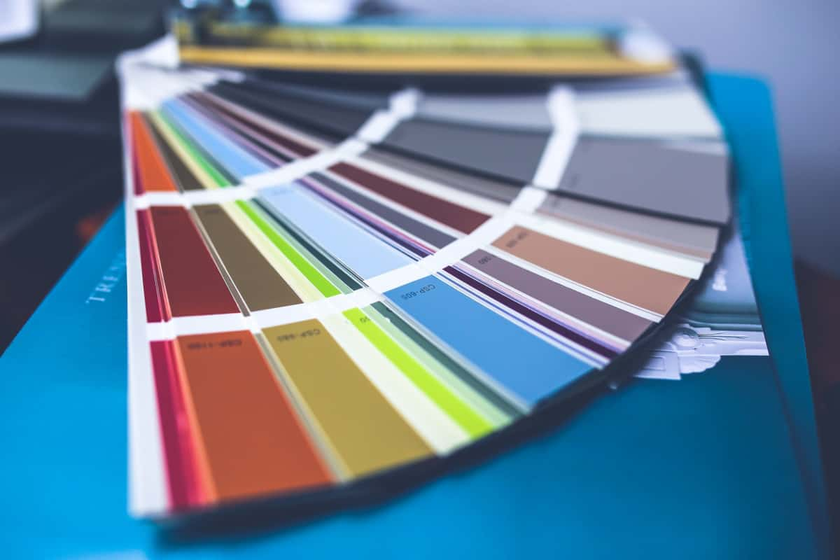 Several paint swatches fanned out.
